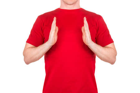 Front view of confident male in red t-shirt show something of small size isolated white background  . Concept of t shirt template and mock-up for print 版權商用圖片