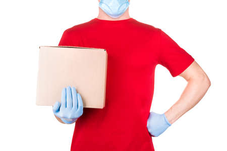 Man in red t-shirt and blue medical gloves holding cardboard box isolated white background  . Concept of safety delivery in virus or coronavirus quarantine