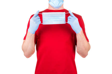 Man in red t-shirt wearing disposable face mask isolated white background  . Concept of medical and healthcare or mock-up for print