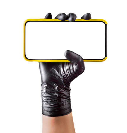 Hand in black glove holding mobile phone with blank screen on white background.