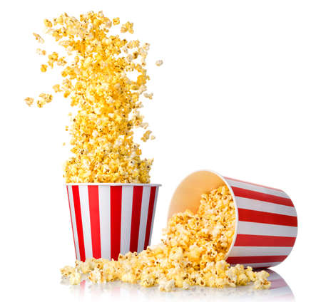Set of flying popcorn from paper striped bucket and scattered popcorn isolated on white background. Concept of cinema or watching TV.