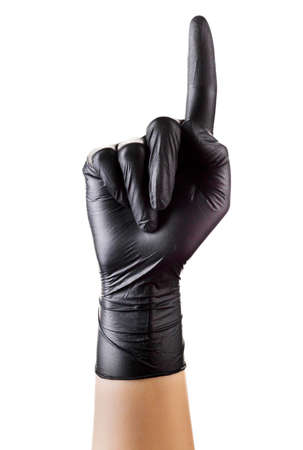 Hand in black gloves with the index finger pointing up isolated on white background. 版權商用圖片