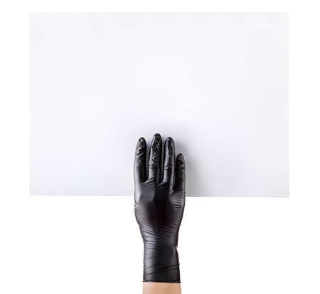Hand in black gloves showing or holding blank cardboard isolated on white background.