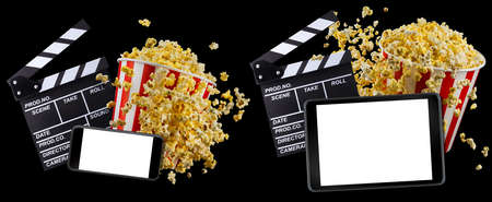 Flying popcorn, film clapper board and phone isolated on black background, concept of watching TV or cinema. 版權商用圖片