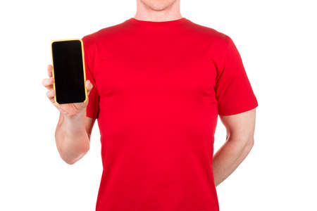 Man in red t-shirt holding mobile phone on his palm isolated white background  . Concept of t shirt template or delivery