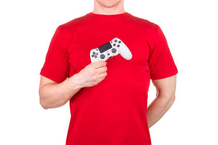 Man in red t-shirt holding video game joysticks gamepad on his palm isolated white background . Concept of t shirt template or delivery 版權商用圖片