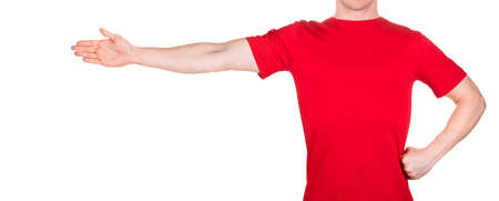 Man in red t-shirt stretched arm and fingers on the side isolated white background  . Concept of t shirt template or delivery 版權商用圖片
