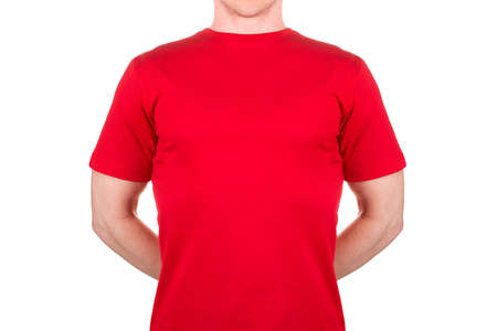 Man in red t-shirt hiding something behind his back isolated on white background  . Concept of t shirt template and mock-up for print 版權商用圖片