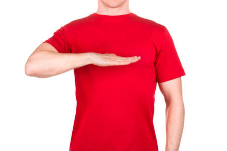 Man in red t-shirt showing height gesture isolated white background  . Concept of t shirt template or delivery
