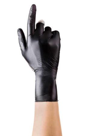 Hand in black gloves with the index finger pointing up isolated on white 版權商用圖片