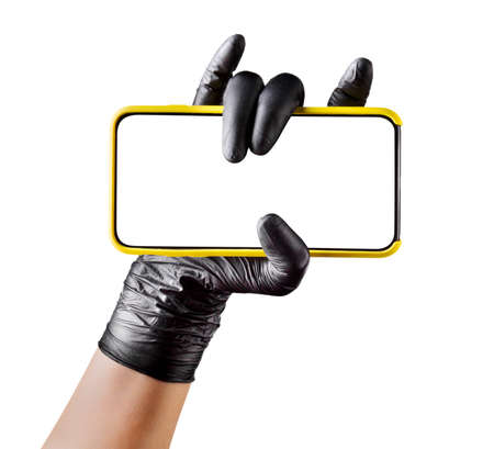 Hand in black glove holding mobile phone with blank screen on white