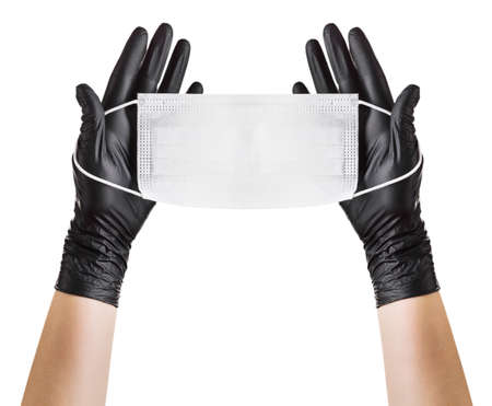 Hand in black gloves wearing disposable face mask isolated on white