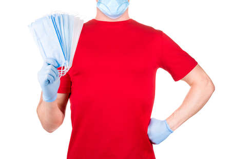 Man in red t-shirt wearing disposable face masks isolated white