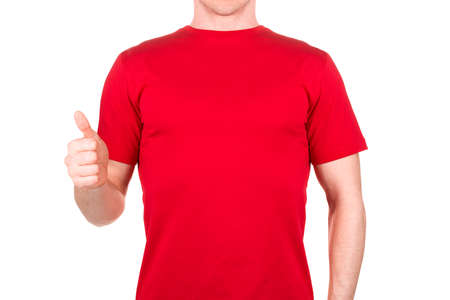 Front view of confident male in red t-shirt showing thumbs up gesture isolated white