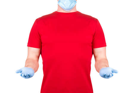 Man in red t-shirt in disposable face mask holding something on his palm isolated white background with clipping path. Concept of t shirt template or delivery