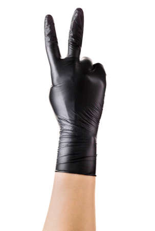 Hand in black gloves showing two fingers up in the peace or victory symbol isolated on white background. Isolated with clipping path.