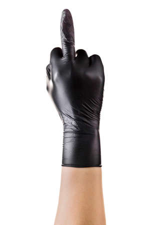 Hand in black gloves middle finger. Gesture of aggression or disrespect on white background. Isolated with clipping path. 版權商用圖片