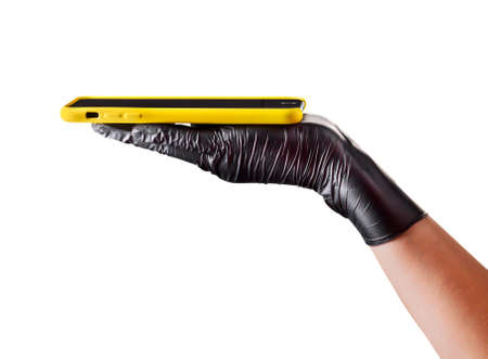 Hand in black glove holding mobile phone with blank screen on white background. Isolated with clipping path.