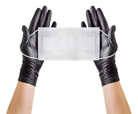 Hand in black gloves wearing disposable face mask isolated on white background with clipping path. Concept of medical and healthcare
