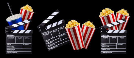 Flying popcorn and film clapper board isolated on black background, concept of watching TV or cinema. 版權商用圖片