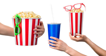 Woman hand holding striped bucket with popcorn isolated on white background. Concept of cinema or watching TV.
