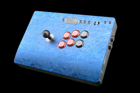Vintage used arcade stick with joystick and tournament grade buttons and scratches isolated on black background. 3D rendering of cybersport hardcore gaming and e-sport tournament concept