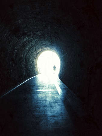 Person at the end of a tunnel