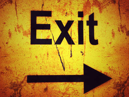 Exit sign on a yellow grunge background