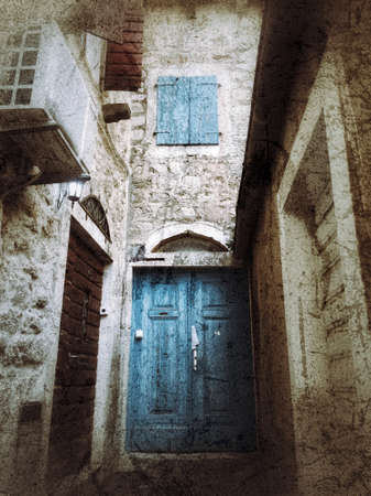 Turquoise blue textured wooden doors and stone entrance Фото со стока