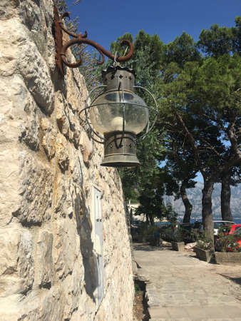 Old lantern at the stone wall