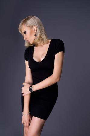 slinky: sexy beautiful blond woman in a slinky dress