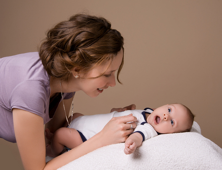 communicates: Mom communicates with her baby