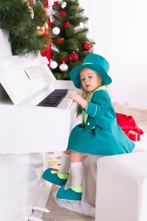 girl in costume leprechaun playing the piano photo