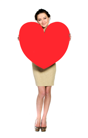 Woman with huge heart made ​​of red paper isolated on white background photo