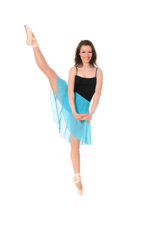 fabrica: ballet dancer in  dance pose in black bathing suit and blue skirt isolated on white background