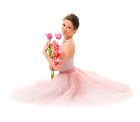 fabrica: ballet dancer hands with pink tulips isolated on white backround Stock Photo
