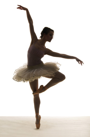 ballet dancing: Silhouette ballet dancer on white background Stock Photo
