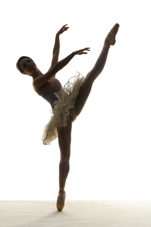 Silhouette ballet dancer on white background photo