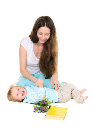 he laughs: Mom tickles his little son, he laughs infectiously Stock Photo