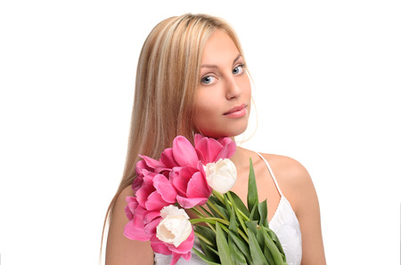 portrait of cute girl with bouquet of flowers isolated on white background photo