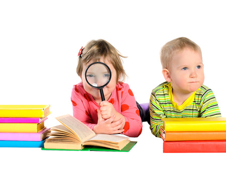 children with multicolored books isolated on white background photo