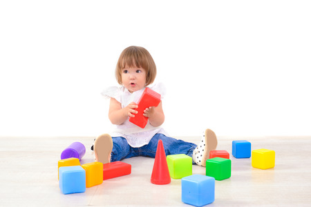 little girl playing with colored cubes photo