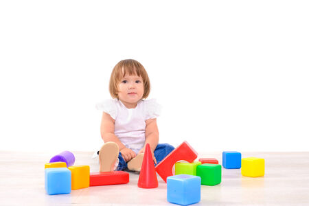 little girl playing with colorful cubes photo