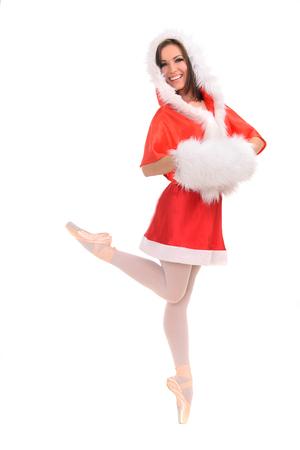 muff: professional ballerina tiptoe in red Christmas dress