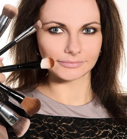 visagiste: female visagiste with brushes closeup