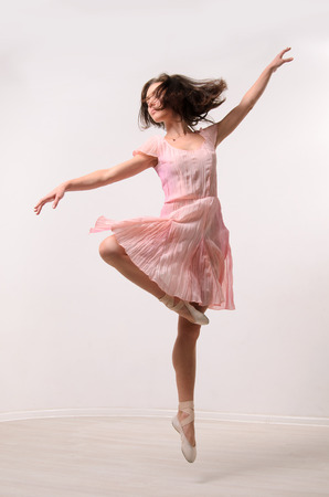 dancing woman: professional jumping ballet female dancer Stock Photo