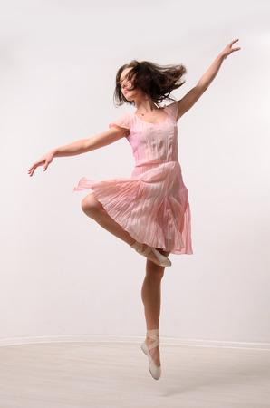 woman dancing: professional jumping ballet female dancer Stock Photo