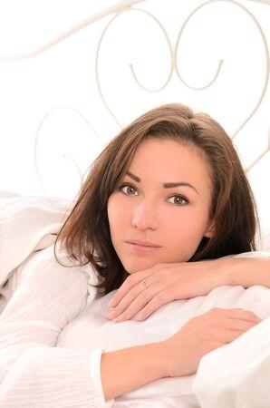 wakening: Morning beautiful sensual girl in a bright bedroom Stock Photo