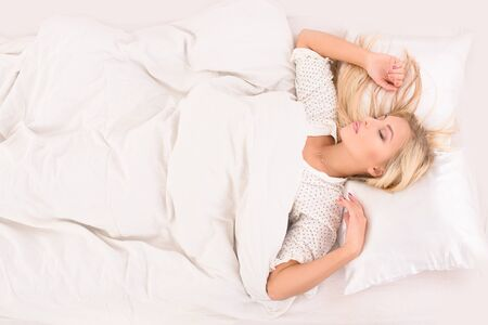 pleasant: pleasant dreams for young attractive blonde woman on white bed