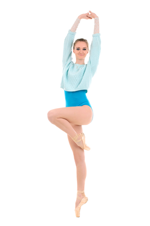 pointes: young ballerina with long legs doing exercises isolated on white background